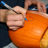 Carving a pumpkin